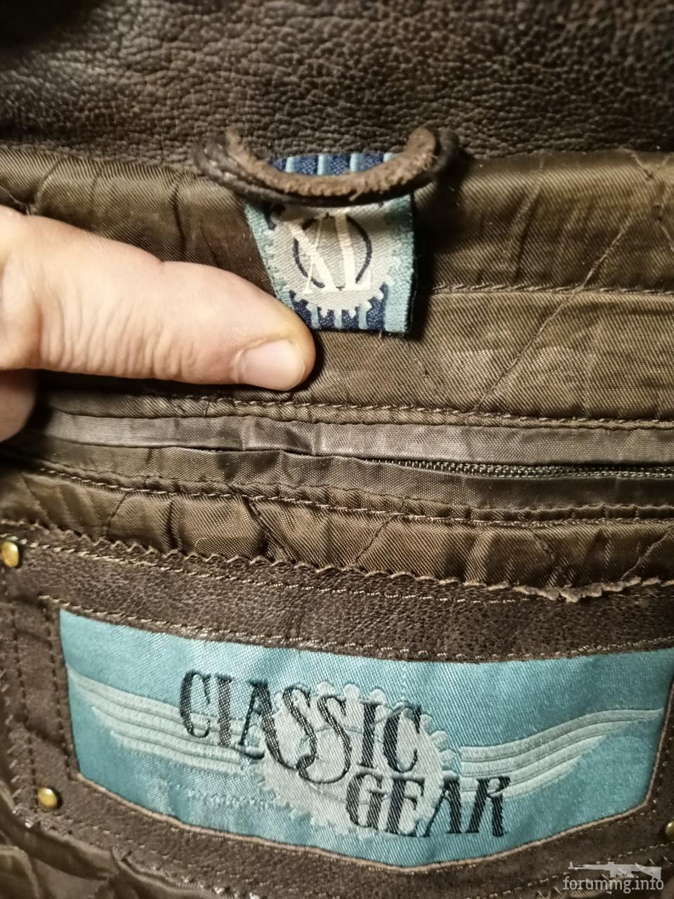 136513 - Шкіряна куртка коричневого кольору