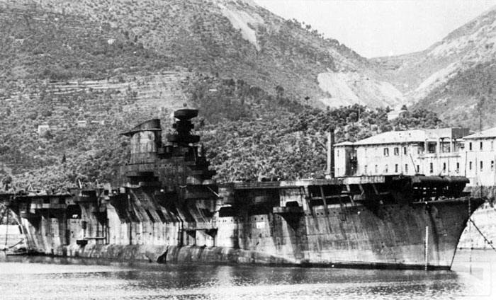 8614 - The rusted hulk of Aquila anchored at La Spezia in 1951, just before being scrapped